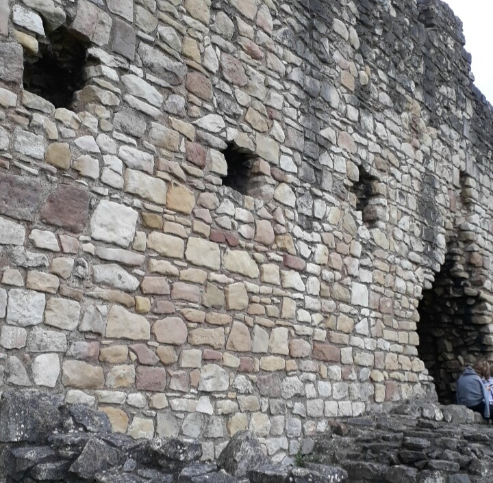 small, 4ft square holes approximately half-way up the castle's outer wall